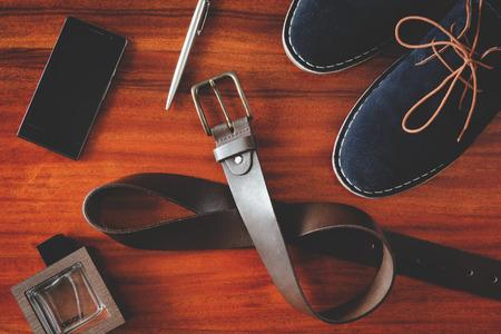 suede belt: set of number mens accessories on wooden table instagram filter