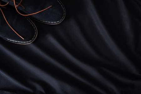 fabrick: mens suede shoes on a black background top view Stock Photo