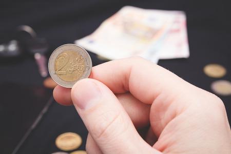 mans hand holding money on the black background photo