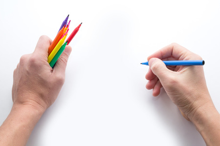 demonstrate: the mans hand, ready to draw a picture felt-tip pen Stock Photo