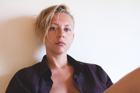 glamour nude: Awesome sexy model with short blonde natural hair, beautiful eyes, full lips, perfect skin posing in mans shirt without make-up