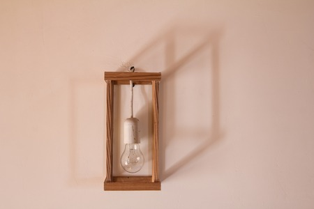 ceiling lamp: lamp in frame on the wall and geometrical shadows Stock Photo
