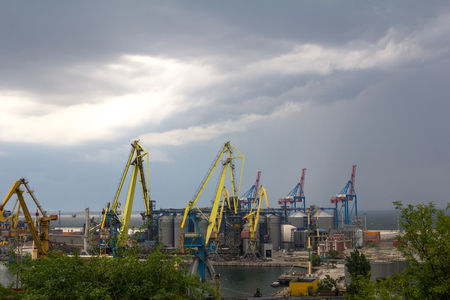panoramatic: Sea port cranes, ships before a storm