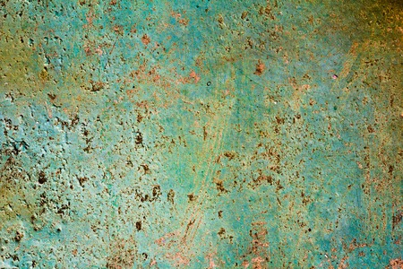 oxidized: Pattern of old painted metal surface. Rusty metal, peeling paint, green tones, bright colors.