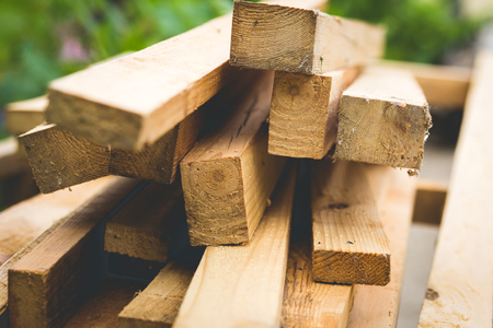 work materials: Cutted wooden boards stacked at the timber yard Stock Photo