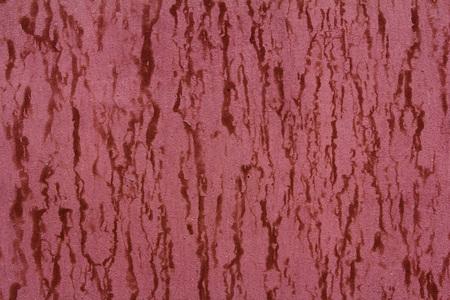 Pattern of old painted metal surface. Rusty metal, peeling paint, red tones, bright colors.