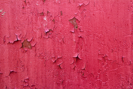 peeling paint: Pattern of old painted metal surface. Rusty metal, peeling paint, red tones, bright colors.