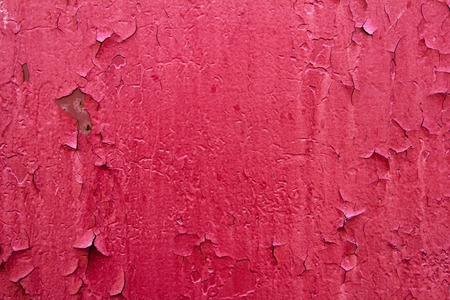 paint peeling: Pattern of old painted metal surface. Rusty metal, peeling paint, red tones, bright colors.