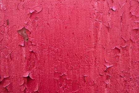 peeling paint: Pattern of old painted metal surface. Rusty metal, peeling paint, red tones, bright colors.