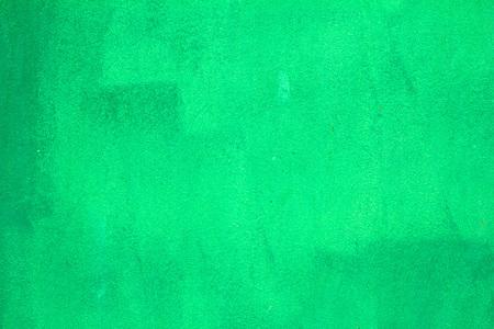 Pattern of old painted metal surface. Rusty metal, peeling paint, green tones, bright colors.