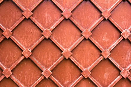 Pattern of old painted metal surface. Rusty metal, peeling paint, brown tones, bright colors.