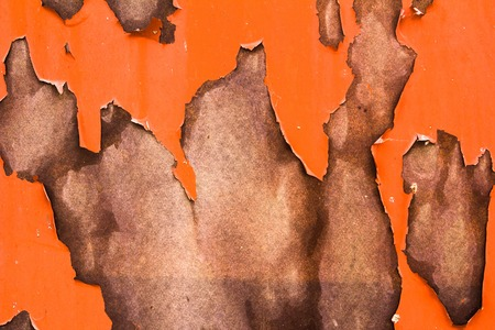 vertical orientation: Orange old obsolete cracked paint texture wall abstract, damaged paint surface abstract, bright brown background in vertical orientation, nobody.