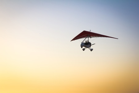 motorized: The motorized hang glider in the morning sky. Stock Photo