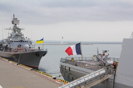 deck cannon: Odesa, UKRAINE - MARCH, 26, 2015: Two battleships, french and ukrainian standing in the sea port