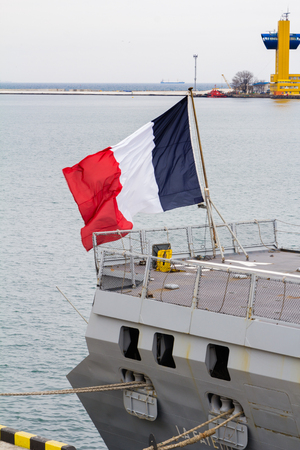 docked: Odesa, UKRAINE - MARCH, 26, 2015: Battleship docked at the harbor with French flag. Editorial