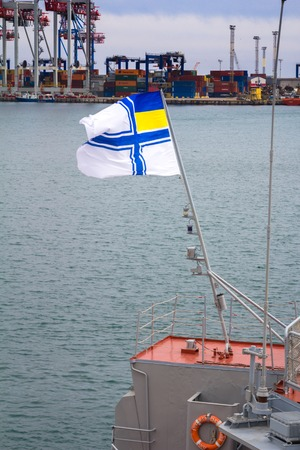 deck cannon: Odesa, UKRAINE - MARCH, 26, 2015: Battleship docked at the harbor with Ukrainian navy flag.