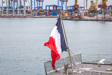 deck cannon: Odesa, UKRAINE - MARCH, 26, 2015: Battleship docked at the harbor with French flag. Editorial