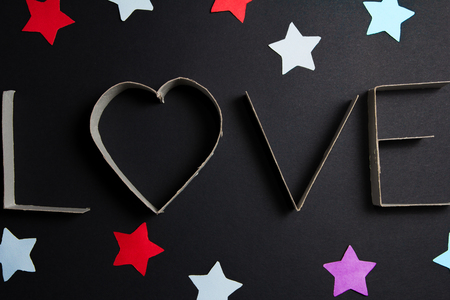 mate: the word love made up of cardboard letters on black mate background Stock Photo