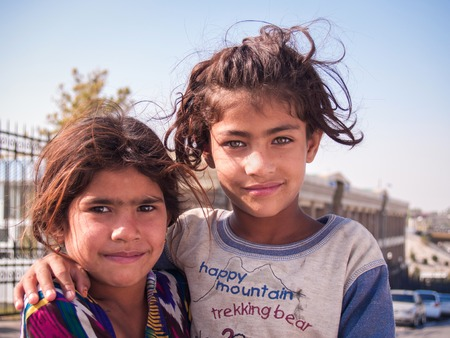 Samarkand, Uzbekistan - October 13, 2010: Two sisters - a refugee from Afghanistan, near the bazaar in Samarkand, Uzbekistan, October 13, 2010.