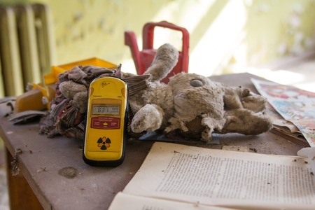 old toys: Dosimeter on old  toys in the abandoned kindergarten Stock Photo