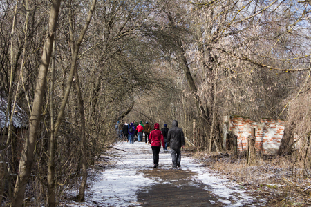 chernobyl: UKRAINE. Chernobyl Exclusion Zone. - 2016.03.19. Tourists strolling through an abandoned village in Chernobyl Exclusion Zone Stock Photo
