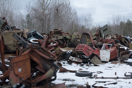 hazardous area sign: abandoned radioactive vehicles took part in the liquidation of Chernobyl disaster
