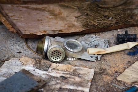 radium: old soviet mask lying on the ground Stock Photo