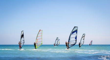 windsurf: Windsurfing sails on the blue sea riding the wind
