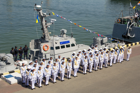 naming: Odesa, Ukraine - July 03, 2016: sailors on the background of the new armored boats during the ship naming ceremony. Editorial