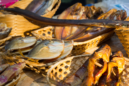 stockfish: Different kinds of dried fish in the store in baskets at beer fesival