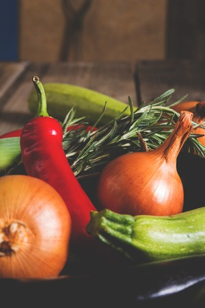 Different kind of local vegitables on the wooden rustic table. Organic healthy food concept Stock Photo