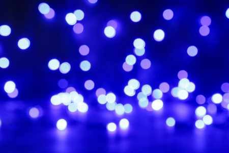 blured: Blured purple, white and blue christmas light background Stock Photo