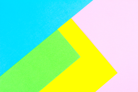 Material design yellow, blue, pink and green paper background. Photo.
