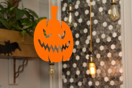 Festive decorations with light bulbs, pumpkins and bats Stock Photo