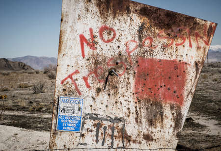 trespassing: No trespassing sign with bullet holes Stock Photo