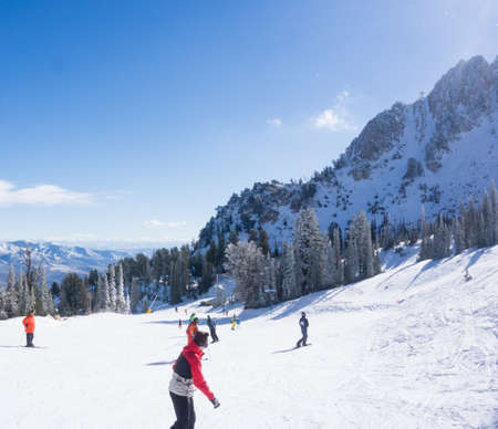 wasatch: Huntsville, UT, November 26, 2014. Skiers and snowboarders enjoy the sun during opening day at Snowbasin ski resort. Editorial