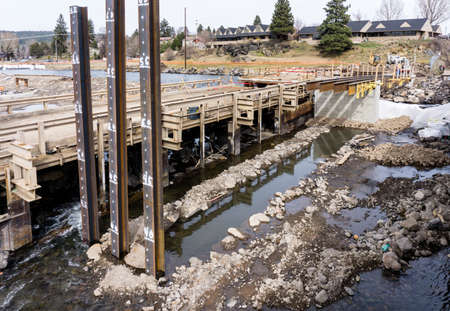 rapid steel: Bend, OR, USA - March 10, 2015 -  Construction on the Deschutes River in Bend, Oregon will remove the Colorado Dam, build new bridges, and improve parks along the river Editorial