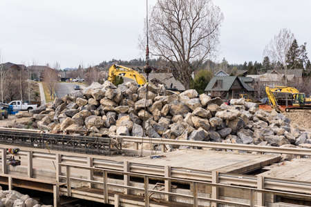 rapid steel: Bend, OR, USA - March 10, 2015 - Construction on the Deschutes River in Bend, Oregon will remove the Colorado Dam, build new bridges, and improve parks along the river