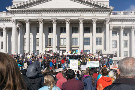 ut: Salt Lake City, UT, USA - January 31, 2015: A crowd gathers in front of the Utah State Capitol building for the Clean Air, No Excuses rally.