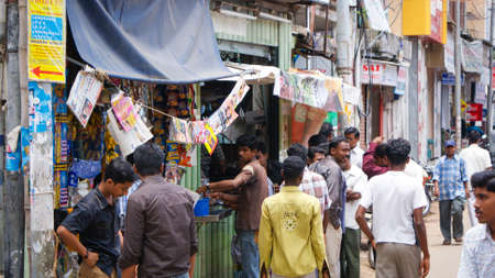 tamil nadu: Madurai, India - September 5, 2008: Men gather outside of a coffee shop in Madurai, Tamil Nadu, India Editorial