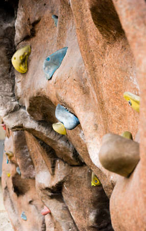 handholds on a climbing wall