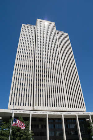 lds: Salt Lake City, Utah, USA - April 18, 2015: The Latter-day Saints Church Office Building stands above flowers and grass in Temple Square, Salt Lake City, Utah.
