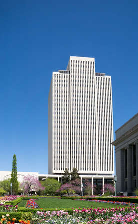 salt lake city: Salt Lake City, Utah, USA - April 18, 2015: The Latter-day Saints Church Office Building stands above flowers and grass in Temple Square, Salt Lake City, Utah.