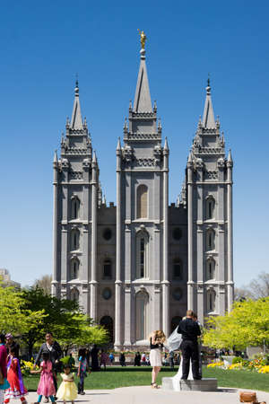lds: Salt Lake City, Utah, USA - April 18, 2015 - A couple gets ready for a wedding picture in front of the Mormon temple in Salt Lake City, Utah.