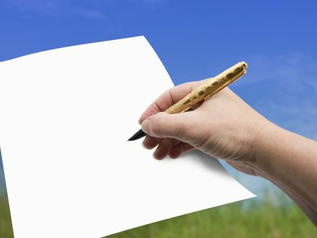 Hand, Pen and Paper - Isolated photo
