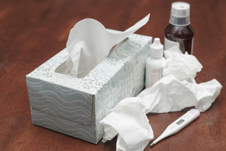 cold medicine with a box of tissue