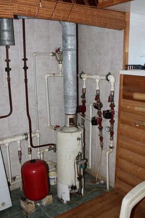Heating system in a private house from a boiler with plastic pipes Reklamní fotografie