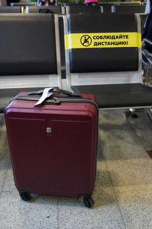 Red Suitcase in Airport Waiting Room Ready for Travel concept