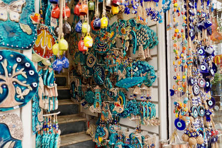 Bodrum, Turkey - August, 2020: souvenirs with evil eyes, masks, lanterns at the local market. Turkish souvenirs of Grand Bazaar. With selective focus. High quality photo