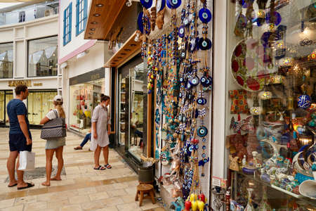 Bodrum, Turkey - August, 2020: souvenirs with evil eyes, masks, lanterns at the local market. Turkish souvenirs of Grand Bazaar. With selective focus
